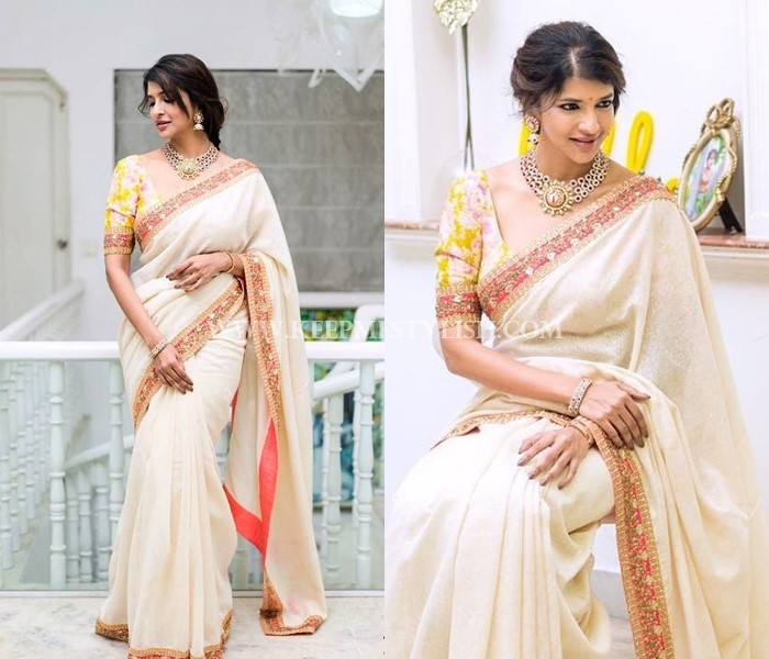 designer white saree with floral blouse