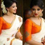 Find Pretty Orange Blouse Designs For Sarees Here